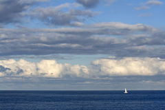 Lonely Boat. Lonely yacht cruising in the ocean stock photography