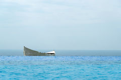 Lonely boat against the blue sea Royalty Free Stock Photos