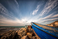 lonely boat ashore against a dramatic sky Stock Images