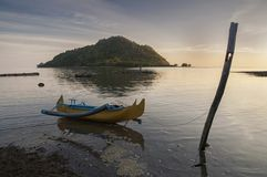 Lonely Boat in Bawean Island. Traditional boat moored on a bamboo, waiting to leave for fish, when time arrive Stock Photo