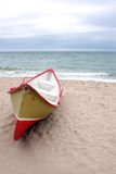 Lonely boat on the beach stock images