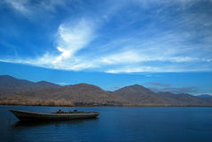 Lonely Boat. At blue sky Royalty Free Stock Photo