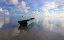 Lonely boat with blue sky Royalty Free Stock Photography