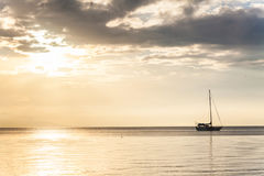Lonely boat in a calm sea for background. Lonely boat in a calm sea for blur background Stock Images