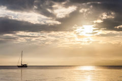 Lonely boat in a calm sea for background. Lonely boat in a calm sea for blur background Royalty Free Stock Photo