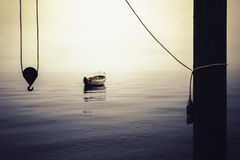 Lonely boat in calm water in the harbor Royalty Free Stock Image