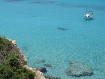 Lonely boat on clean waters. In the sea of Formentera - Baleares Islands royalty free stock photo