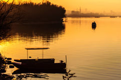 Lonely boat on Danube. In sunset Stock Photo