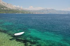Lonely boat floating alone on beach of Korcula, Croatia Royalty Free Stock Image