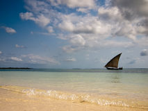 Lonely boat floating in the sea. On a background of the sky Stock Images