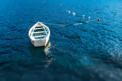 Lonely boat floating Royalty Free Stock Photography