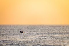 Lonely Boat in the Horizon stock image