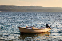 Lonely Boat and Island Brac at Sunset, Dalmatia Royalty Free Stock Photography