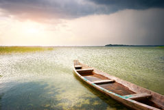 Lonely boat on lake Stock Photos