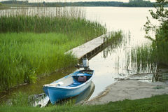 Lonely boat. On the lake stock photography