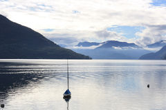 A lonely boat on Lake Maggiore Stock Photo