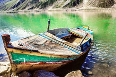 Lonely boat at lake saif ul malook Royalty Free Stock Images