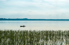 Lonely boat on the lake Royalty Free Stock Image