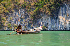 Lonely boat Longtail. Near islands in the Andaman Sea Royalty Free Stock Image