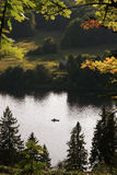 Lonely boat in the middle of the river at summer Stock Images