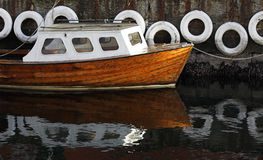Lonely boat near a mooring Royalty Free Stock Photography