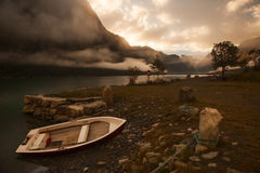 Lonely boat near the shore, Norway. Lonely boat near the shore, autumn, Norway royalty free stock photo