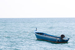 Lonely boat in the ocean Royalty Free Stock Photo