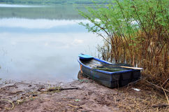 Lonely boat of river Stock Images