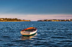 The lonely boat. Lonely boat sailing free in mediterranean sea royalty free stock photo