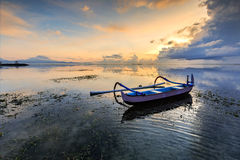 Lonely boat at sanur beach, Indonesia Stock Photos