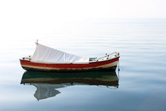 Lonely Boat in the Sea. One rowing boat in the open sea. Photo taken in Thessaloniki, Greece Royalty Free Stock Photo