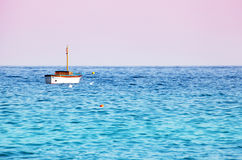 Lonely boat in the sea Stock Images