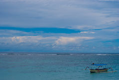 Lonely boat on the sea in Bali Stock Photo