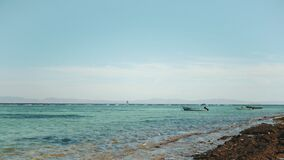 Lonely boat at sea of Egypt,Beautiful landscape of blue sea and clear sky, waves crash against a stone coast, Dahab
