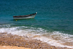 Lonely boat on a sea Stock Image