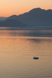 Lonely boat in the sea on sunrise Royalty Free Stock Photos