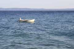 Lonely boat in the sea Royalty Free Stock Image