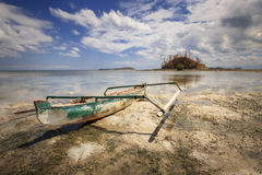Lonely boat when stranded with blue sky, dramatic cloud and reflection Royalty Free Stock Image