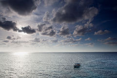 Lonely boat at sunset Royalty Free Stock Image