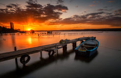 Lonely boat at sunset Stock Photography