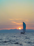 Lonely boat at sunset Royalty Free Stock Photography
