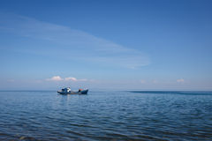 Lonely boat on water Baikal lake in blue sky Royalty Free Stock Image