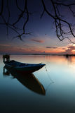 Lonely boat on water with reflection Royalty Free Stock Photography