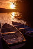 Lonely boats at sunset - relax Stock Images