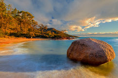 Lonely Boulder. Boulder at the beach in Honeymoon Bay, Freycinet Peninsula, Tasmania Royalty Free Stock Images
