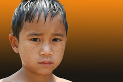 Lonely boy. Close-up of young boy stock images