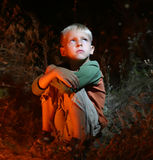 Lonely boy in the dark Royalty Free Stock Image