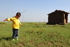 Lonely boy in the field Royalty Free Stock Photography