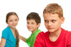 Lonely boy among his happy friends Stock Photography