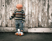 Lonely boy with toy Royalty Free Stock Photos